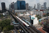 A BTS train drives along a railway track in Bangkok on March 20 2013 Thailand's cabinet approved a plan to spend 68 billion USD on a highspeed...