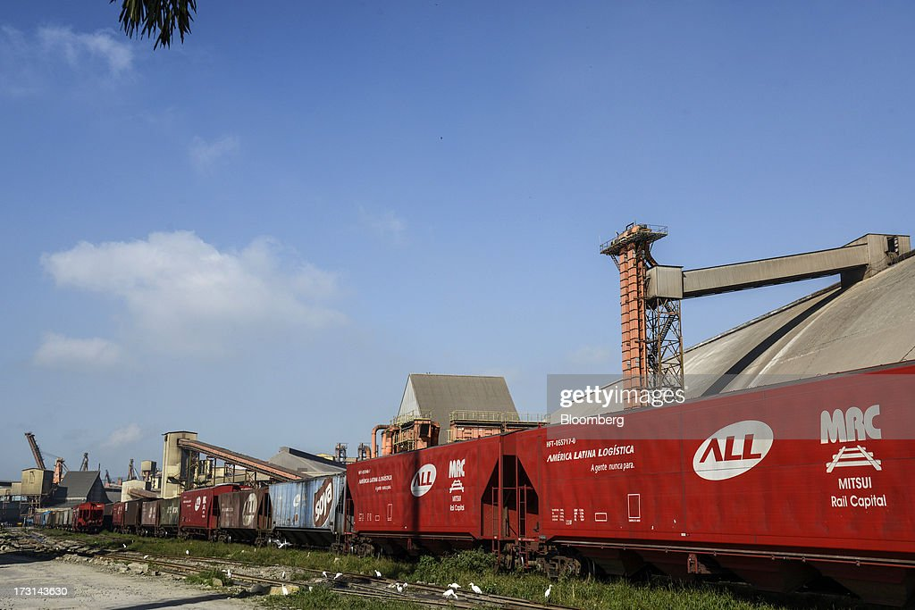 A train filled with grain passes through the Port of Santos in Santos, Brazil, on Friday, July 5, 2013. Rising borrowing costs and the global bond selloff triggered by the prospect of reduced U.S. stimulus are prompting Brazilian investors to boost holdings of the countrys floating-rate securities. Photographer: Paulo Fridman/Bloomberg via Getty Images