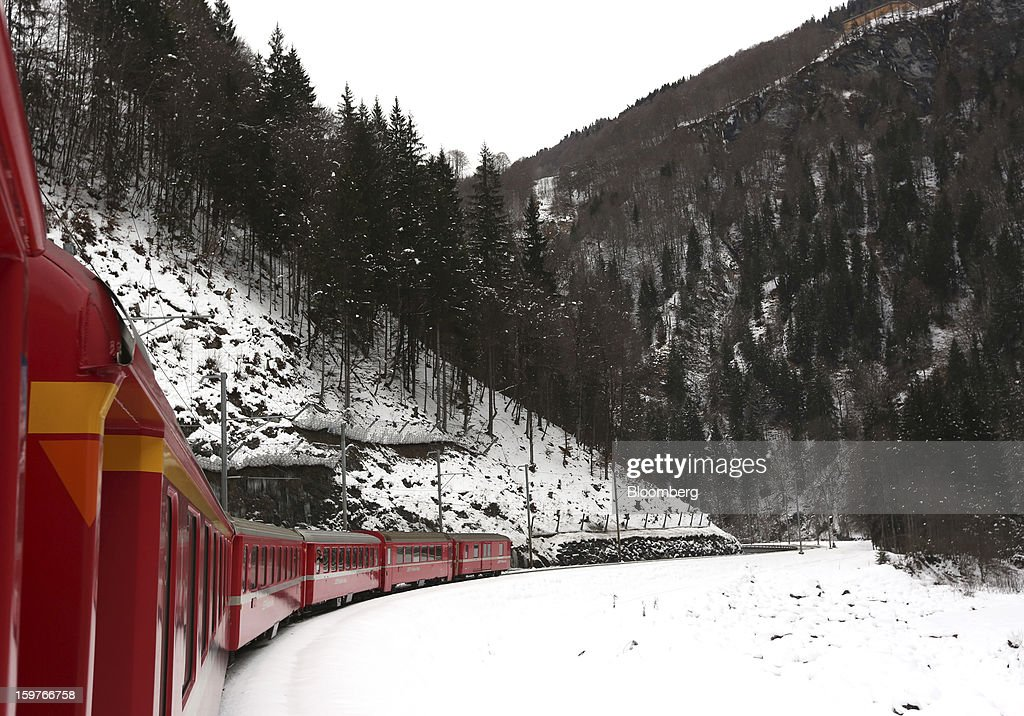 A train from the Rhaetian Railway (RhB) moves along the track after leaving Landquart towards Davos, Switzerland, on Sunday, Jan. 20, 2013. Next week the business elite gathers in the Swiss Alps for the 43rd annual meeting of the World Economic Forum in Davos, the five day event that will run from Jan. 23-27. Photographer: Jason Alden/Bloomberg via Getty Images