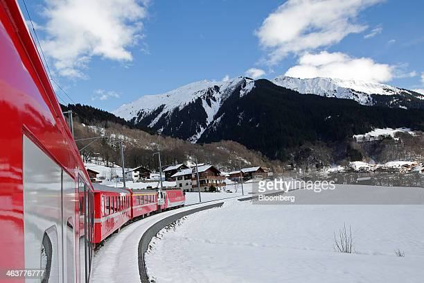A train from the Rhaetian Railway moves along the track after leaving Landquart towards Davos Switzerland on Sunday Jan 19 2014 Next week the...
