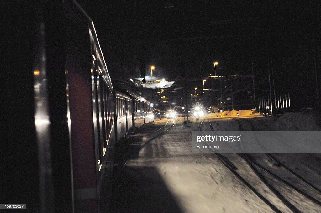 A train from the Rhaetian Railway (RhB) moves along the track late at night after leaving Landquart towards the town of Davos, Switzerland, on Friday, Jan. 18, 2013. Next week the business elite gathers in the Swiss Alps for the 43rd annual meeting of the World Economic Forum in Davos, the five day event runs from Jan. 23-27. Photographer: Bryn Colton/Bloomberg via Getty Images