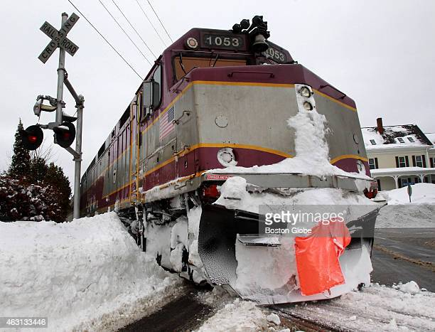 A train from the Rockport branch of the MBTA commuter rail crosses Washington Street in Gloucester Mass on February 10 heading toward Boston Because...