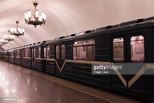 Train inside Metro underground rail station.