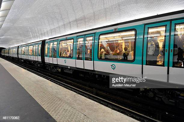 A train is at the platform as people observe a one minute of silence in the metro station the day after the terrorist attack at Charlie Hebdo on...