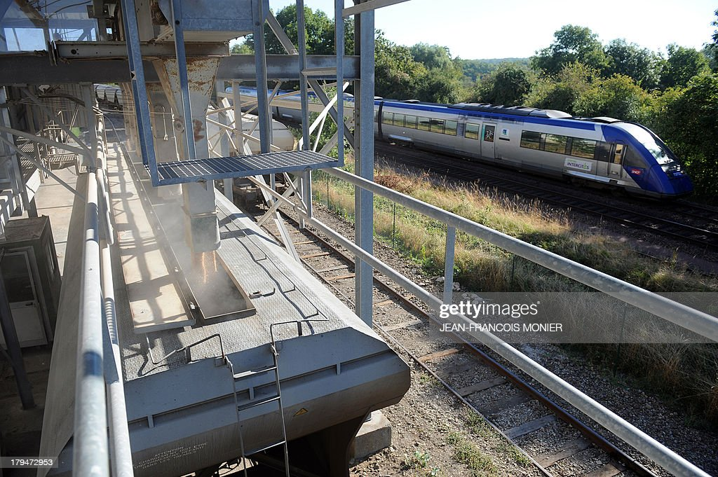 A train is loaded with wheat by Agrial, an agricultural cooperative on september 4, 2013 in Coulombiers, Western France. Some 1200 tonnes of wheat are loaded into 21 wagons and transported directly to the cooperative rather than by road to ease congestion.