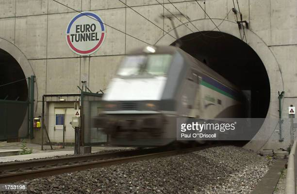 A train is shown exiting a tunnel June 13 2002 at Calais France French authorities have increased searches of freight trains before they leave for...