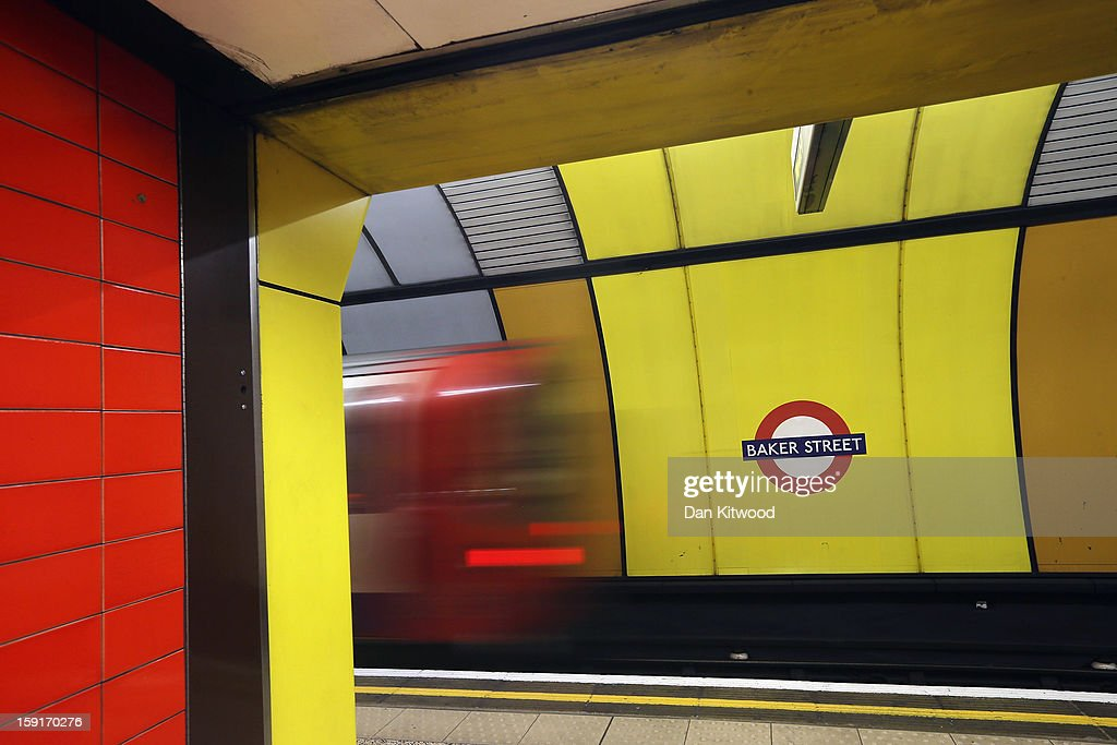 A train leaves a platform at Baker Street Underground Station on January 9, 2013 in London, England. Baker Street Station shares the 150th Anniversary of its opening on January 10th, 2013 with the London Underground. Commonly called the Tube, the London Underground is the oldest of its kind in the world and now carries approximately a quarter of a million people around its network of 249 miles of track every day. Baker Street station was remodeled between 1911-13 by architect Charles W Clark to its present form as part of a comprehensive rebuilding project by the Metropolitan Railways with the station as its new company headquarters and flagship station, where it quickly became known as the 'Gateway to Metro - Land'. Outside the Marylebone Road exit, a large statue commemorates Sherlock Holmes, Sir Arthur Conan Doyles ficticious detective who resided in the novels at 221B Baker Street.