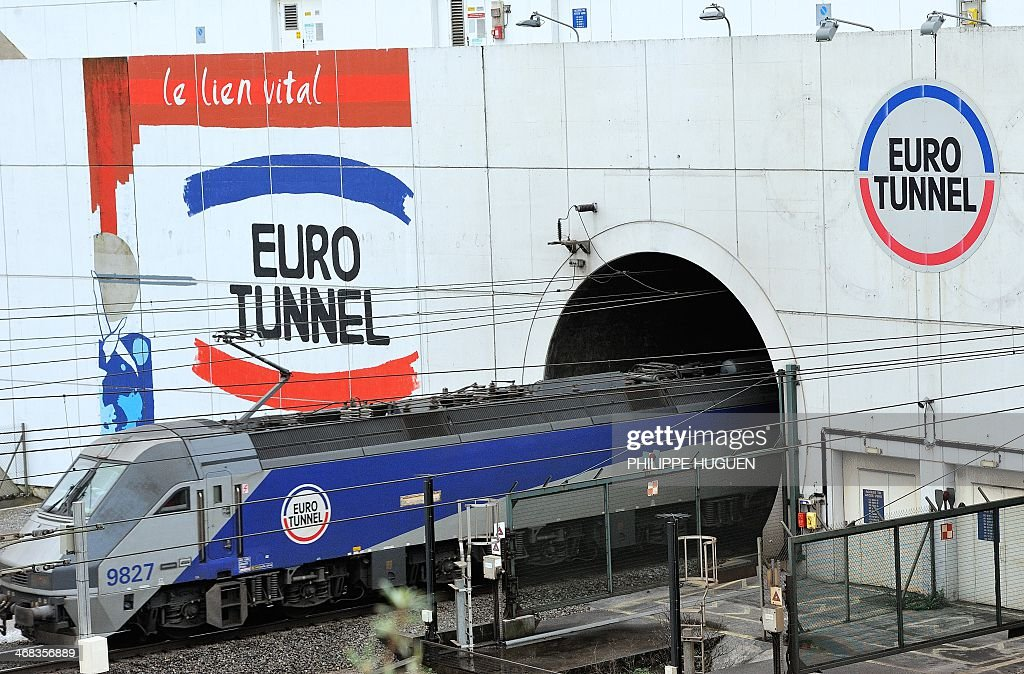A train leaves on February 10, 2014 near Coquelles, northern France, the Eurotunnel. The train tunnel, which runs beneath the Channel between northern France and southern England, wa inaugurated in 1994. HUGUEN