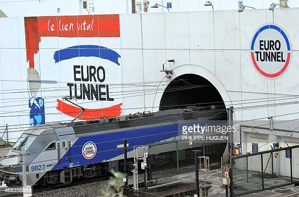 A train leaves on February 10 2014 near Coquelles northern France the Eurotunnel The train tunnel which runs beneath the Channel between northern...