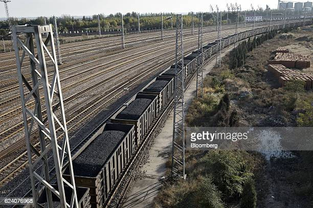 A train loaded with coal travels towards the Qinhuangdao Port in Qinhuangdao China on Friday Oct 28 2016 China's efforts to quell surging coal prices...