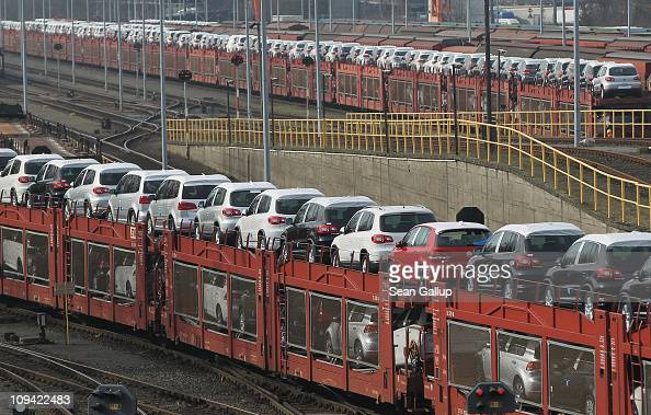 A train loaded with new Volkswagen Golf Tiguan and Touran cars rolls from the Volkswagen factory on February 25 2011 in Wolfsburg Germany Volkswagen...