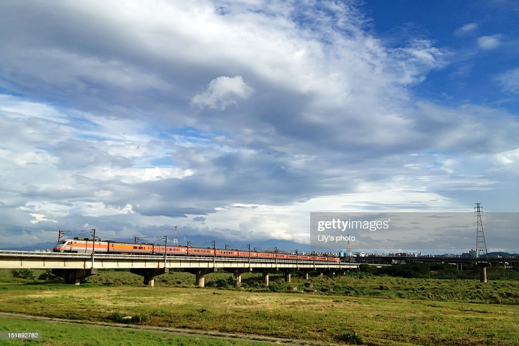 Train moving on bridge : Stock Photo
