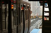Train moving on the tracks at CTA Station in Chicago