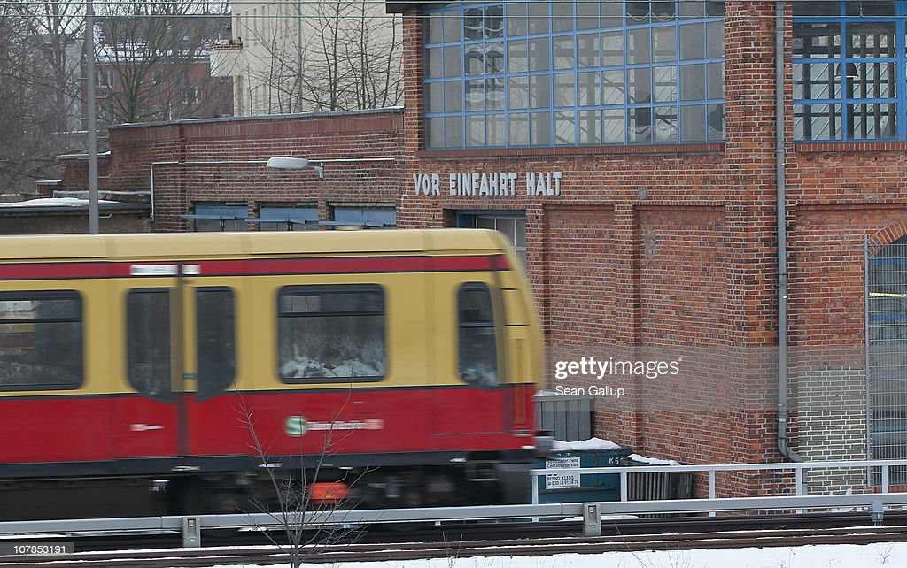 A train of the Berlin S-Bahn commuter rail network passes by an S-Bahn maintenance facility on January 3, 2011 in Berlin, Germany. According to media reports out of the S-Bahn's 1,100 train cars only 426 are in service. The others, according to S-Bahn officials, are in repair due to damage caused by the early and harsh winter weather this year. The shortfall in operating trains has led to longer waits for commuters and, in some cases, cancelled service to outlying districts altogether. The Berlin S-Bahn, a subsidiary of the German state rail carrier Deutsche Bahn, has been unable to keep its full fleet of trains operational for the last two years, and critics charge the shortfalls are due to inadequate investment in facilities and personnel.