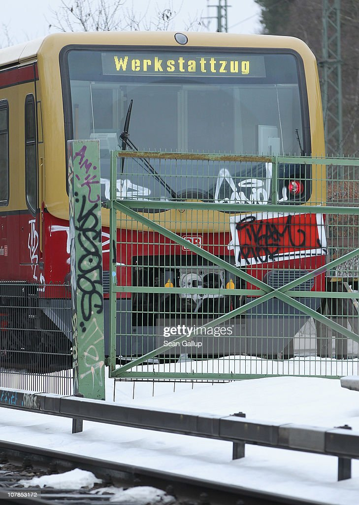 A train of the Berlin S-Bahn commuter rail network stands idle near an S-Bahn maintenance facility on January 3, 2011 in Berlin, Germany. According to media reports out of the S-Bahn's 1,100 train cars only 426 are in service. The others, according to S-Bahn officials, are in repair due to damage caused by the early and harsh winter weather this year. The shortfall in operating trains has led to longer waits for commuters and, in some cases, cancelled service to outlying districts altogether. The Berlin S-Bahn, a subsidiary of the German state rail carrier Deutsche Bahn, has been unable to keep its full fleet of trains operational for the last two years, and critics charge the shortfalls are due to inadequate investment in facilities and personnel.