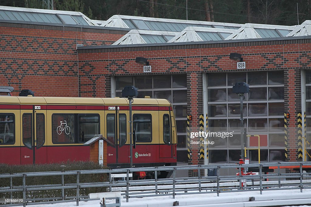 A train of the Berlin S-Bahn commuter rail network stands idle outside an S-Bahn maintenance facility on January 3, 2011 in Berlin, Germany. According to media reports out of the S-Bahn's 1,100 train cars only 426 are in service. The others, according to S-Bahn officials, are in repair due to damage caused by the early and harsh winter weather this year. The shortfall in operating trains has led to longer waits for commuters and, in some cases, cancelled service to outlying districts altogether. The Berlin S-Bahn, a subsidiary of the German state rail carrier Deutsche Bahn, has been unable to keep its full fleet of trains operational for the last two years, and critics charge the shortfalls are due to inadequate investment in facilities and personnel.