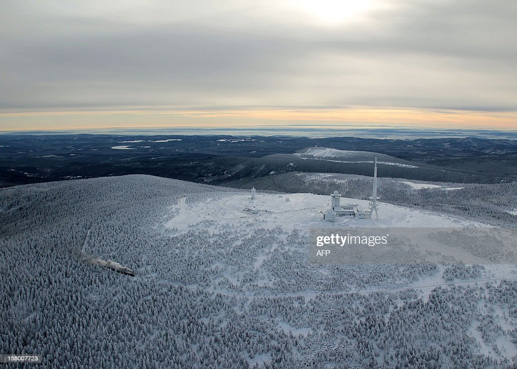A train of the Brocken Railway steams through the winter landscape with snow covered pine trees on Brocken Mountain in Harz, Germany, on December 8, 2012. AFP PHOTO / Stefan Rampfel /GERMANY OUT
