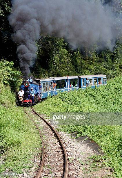 A train of the Darjeeling Himalayan railway also known as the Toy Train moves along the the track on its way to the hill station of Darjeeling from...