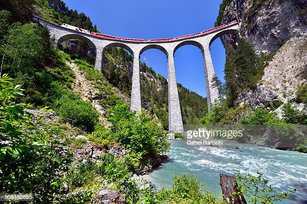 A train of the Rhaetian Railway on the Landwasser Viaduct, UNESCO World Heritage Site, near Filisur, Canton of Grisons, Switzerland