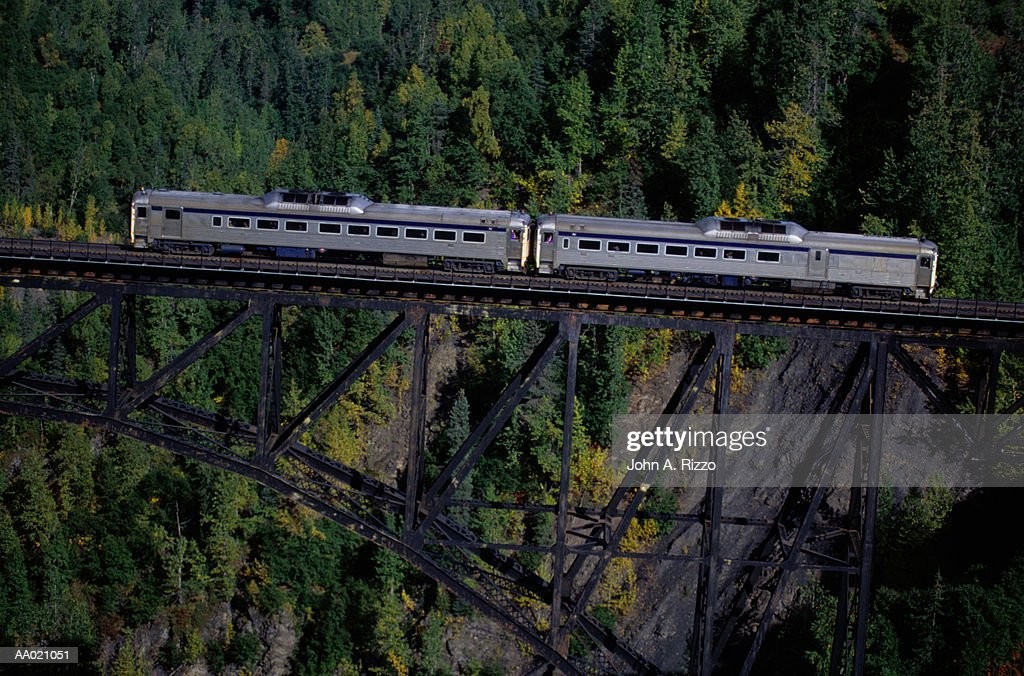Train on a Bridge Between Mountains