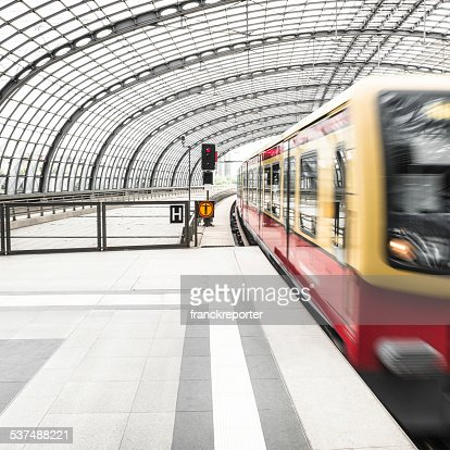 train on motion on a futuristic station