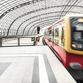 train on motion on a futuristic station