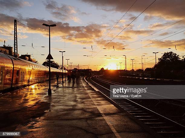 Train On Railroad Station Against Sky During Sunset