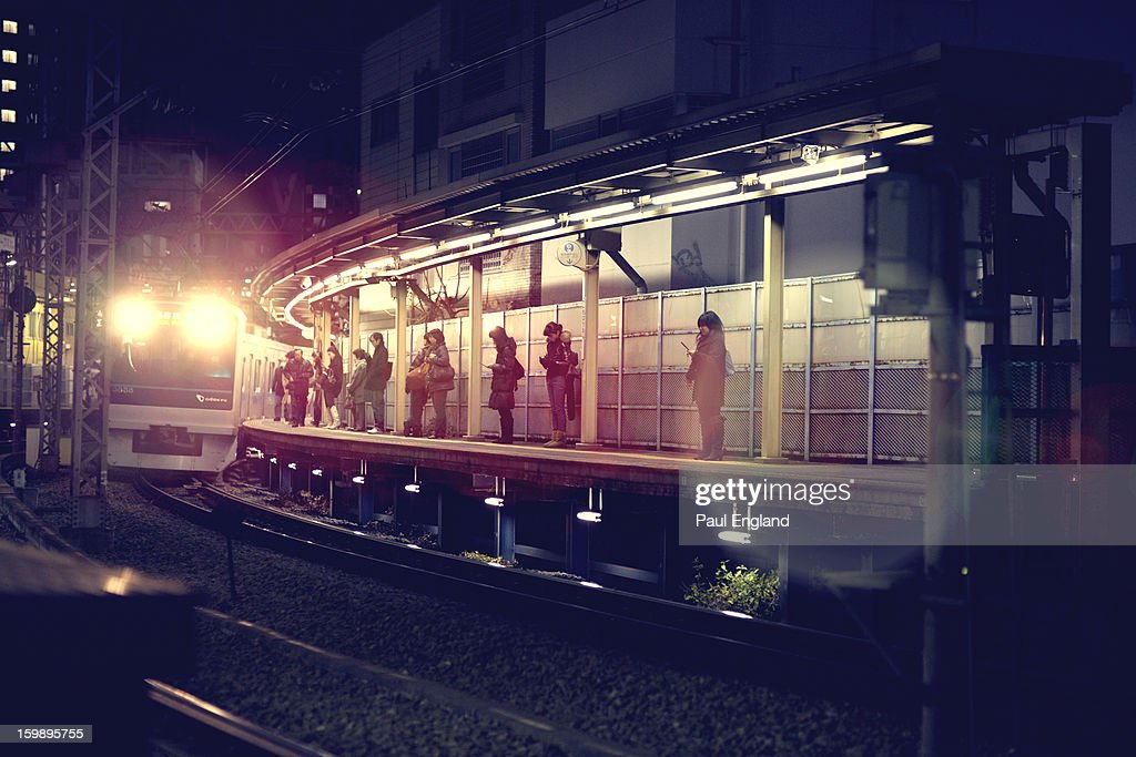 CONTENT] A train on the Odakyu Line comes to a stop to pick up passengers.