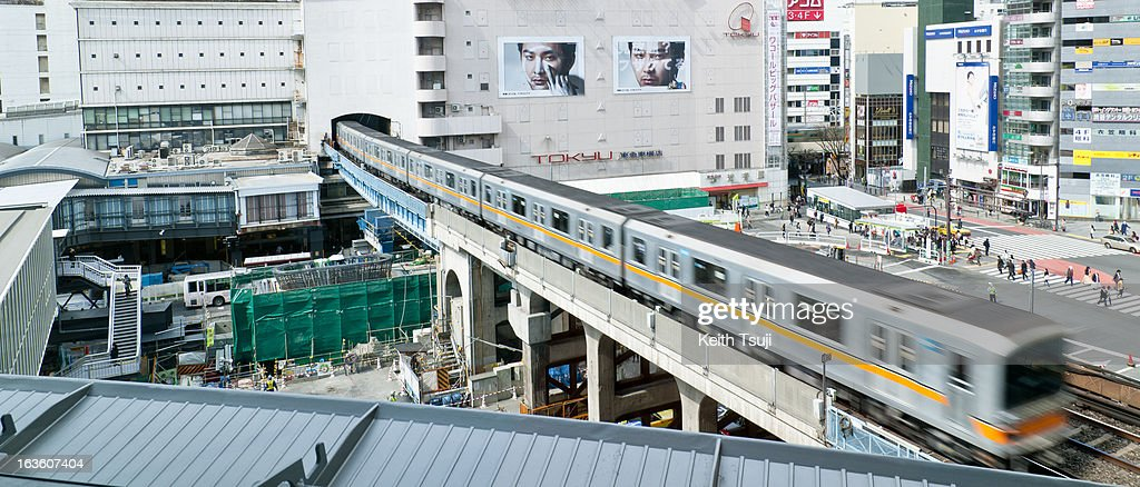 A train passes through Shibuya, on March 13, 2013 in Tokyo, Japan. Tokyu Toyoko Line Shibuya Station will be relocated underground and will join the Fukutoshin Line in March 2013, rendering Shibuya out of use after 85 years of history. A large scale redevelopment around Shibuya station is also scheduled.