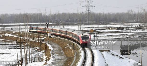 A train passes through snowcovered track at Mazhama on February 1 2017 north of Srinagar India The first Union Budget comprising allocations to and...