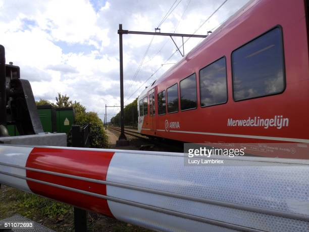 Train passing behind boom barrier Arriva Dordrecht Netherlands