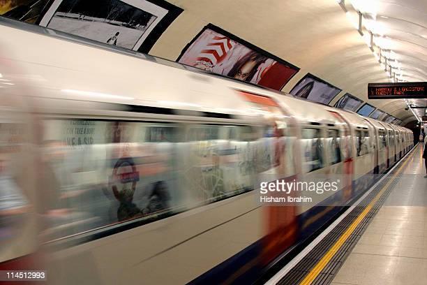 Train passing through subway station, London, UK