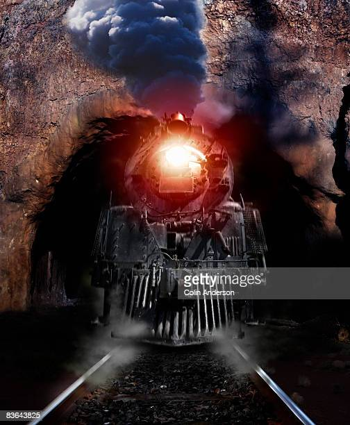 train powering out of a tunnel