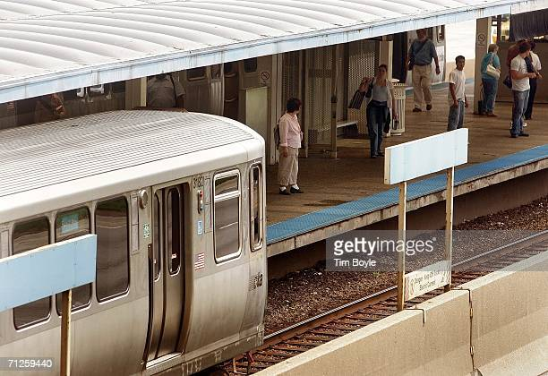 train pulls into a station along the Kennedy Expressway June 21 2006 in Chicago Illinois The American Public Transportation Association estimates 14...