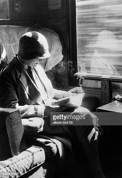 Train rides Smoking woman in a second class compartment 1931 Published by 'Die Gruene Post' 30/1931 Vintage property of ullstein bild