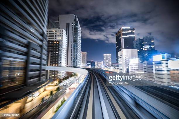 Train Riding Through Tokyo at Night