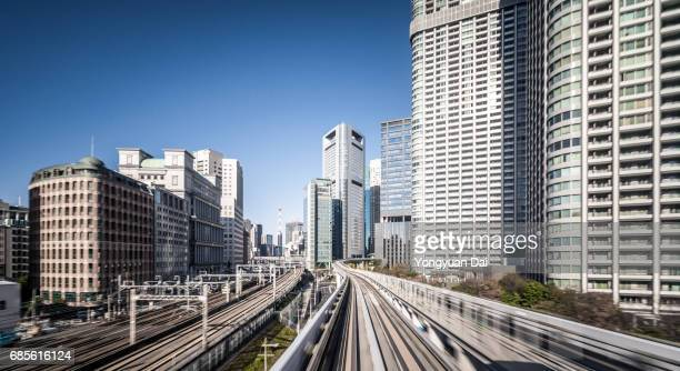 Train Riding Through Tokyo