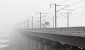 A train runs under heavy smog in Dalian northeast China's Liaoning province on January 29 2013 Residents across northern China battled through...