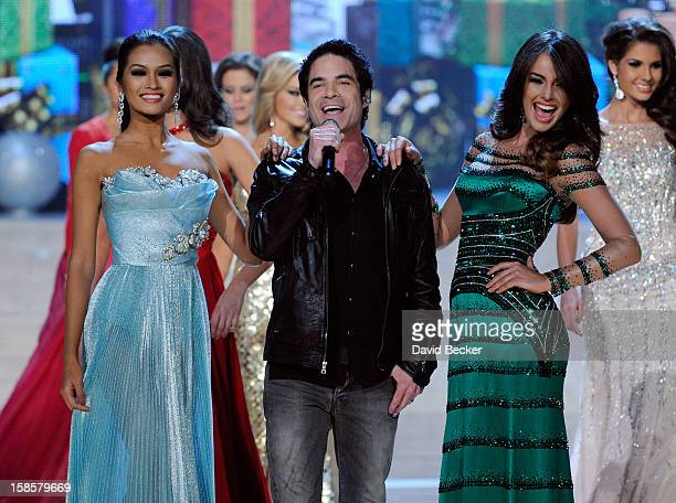 Train singer Pat Monahan is flanked by Miss Philippines 2012 Janine Tugonon and Miss Venezuela 2012 Irene Sofia Esser Quintero as he performs during...