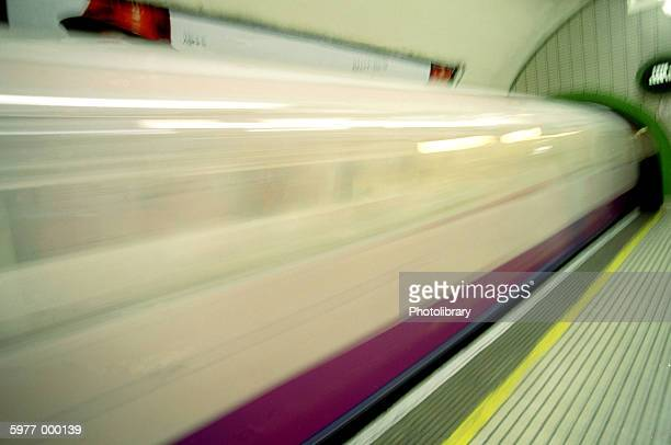 train speeding past underground railway station