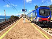 Italian railway station by train. Overlooking on the Mediterranean Sea.