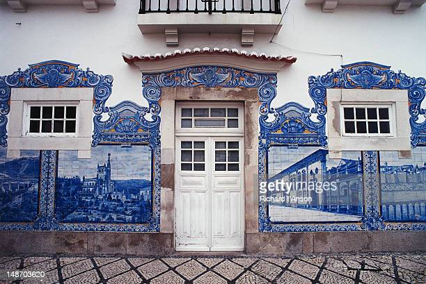 Train station wall decorated with blue and white azulejos (hand painted tiles).