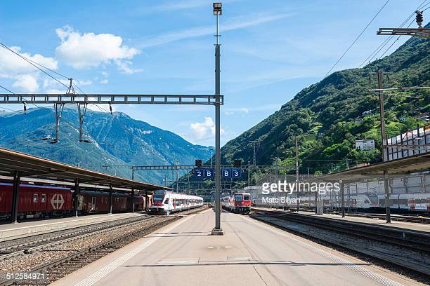 Train station with blue sky and mountains in Bellinzona Switzerland