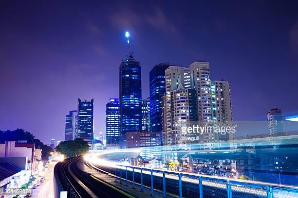 train through city with blur trail
