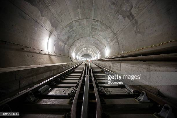 Train tracks lead towards an access tunnel inside the east section of the Gotthard Base Tunnel in Faido Switzerland on Tuesday July 15 2014 Drilling...