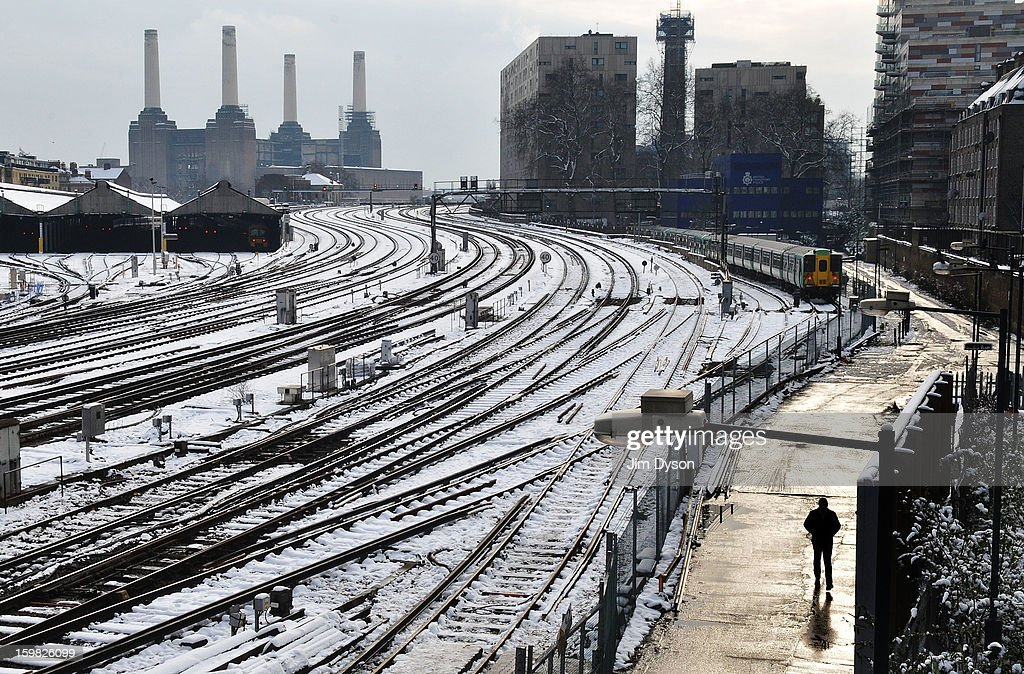 Train tracks south of Victoria station are pictured in snow, in front of Battersea Power Station on January 21, 2013 in London, United Kingdom. The United Kingdom has suffered a weekend of heavy snowfall with transport routes affected including the cancellation of many rail services.