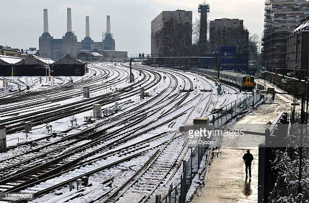 Train tracks south of Victoria station are pictured in snow in front of Battersea Power Station on January 21 2013 in London United Kingdom The...