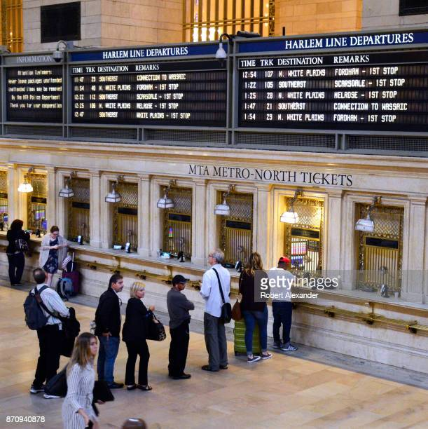 Train travelers purchase tickets in the Main Concourse of Grand Central Terminal in New York New York The Midtown Manhattan landmark is a commuter...