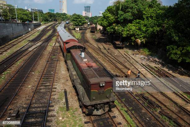 A train travels along railway tracks in Colombo Sri Lanka on Thursday April 20 2017 The Central Bank of Sri Lanka is scheduled to announce its key...
