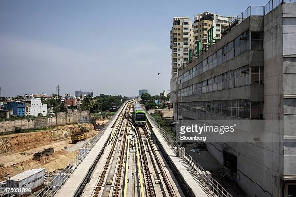 A train travels towards at Mantri Sampige Square Metro station operated by Bangalore Metro Rail Corp in Bengaluru India on Sunday May 3 2015 Oriental...